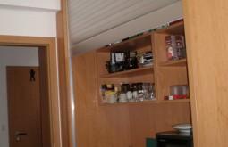 Kuchyňka skrytá roletou